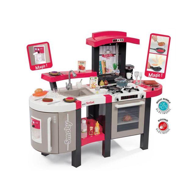SMOBY Cuisine enfant Super Chef Deluxe Téfal Une cuisine Super Chef de Luxe Téfal de Smoby pour enfants. Véritable cuisine avec son équipement complet : hotte, évier, four, frigo, machine à espresso, etc. Et 46 accessoires inclus avec la cuisine Smoby de