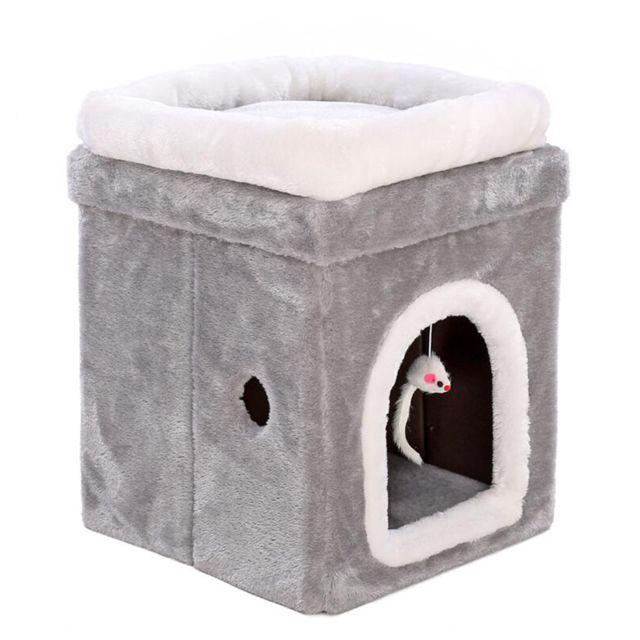 Cadre s'élevant pliable de chat d'animal familier de triangle contre le mur avec le nid