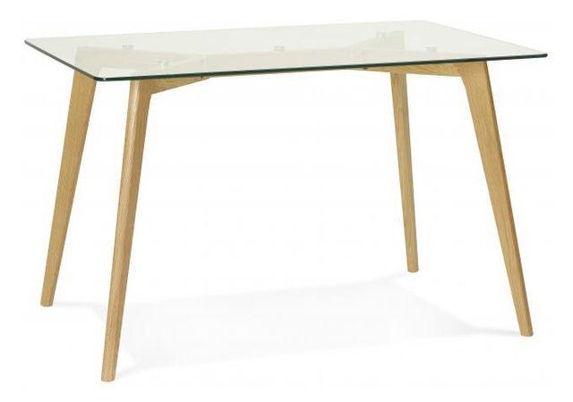Declikdeco C'est à travers son beau design transparent que cette Table à manger rectangulaire avec plateau en verre pieds bois Fior