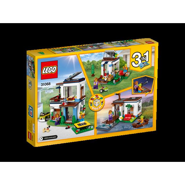Lego La maison moderne - 31068 Découvrez la maison moderne 3-en-1 lumineuse et aérée, avec une verrière, de grandes fenêtres, un intérieur détaillé, un trampoline, une voiture et deux figurines. Se tr