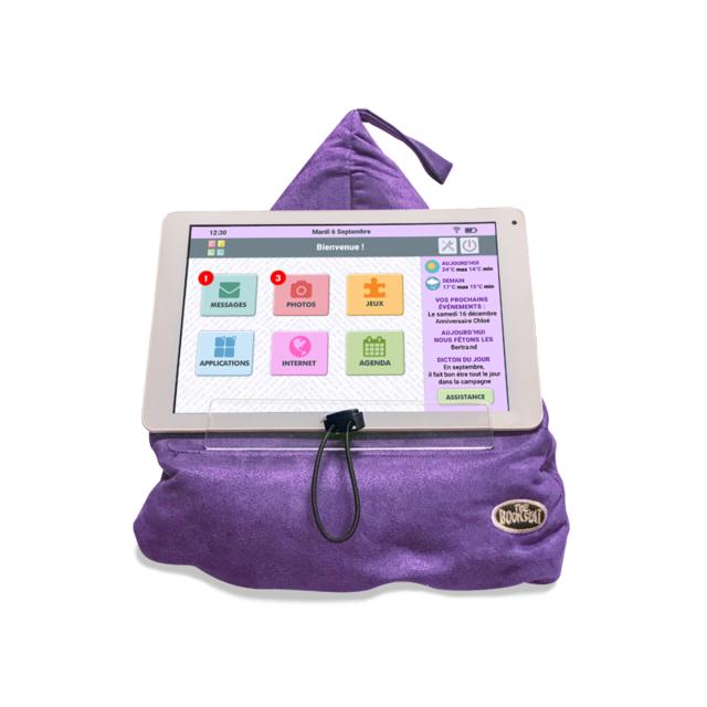 """Marque Generique Support coussin pour tablette violet Grâce à son principe de """"pouf"""" rempli de microbilles, ce support coussin peut se placer sur vos genoux, sur le ventre, sur le lit, sur un accoudoir, sur un bureau, ou une table.Il vous offre"""