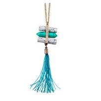 Collection Zanzybar - Collier sautoir mode avec pompons et pierre turquoise et marbre Collection Jade