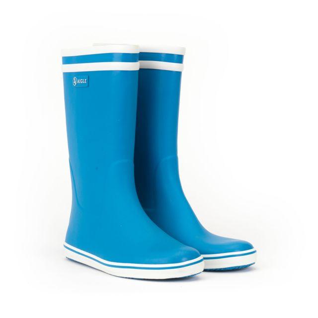 AIGLE BOTTES CAOUTCHOUC FEMME Botte emblématique avec ses deux bandes blanches, c'est la référence des bottes de pluie ; Elle est pratique et confortable