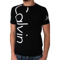 Calvin Klein - T-shirt Jeans manches courtes. Coupe ajustée, près du corps. Matière confortable avec élasthanne. Col rond. Logo imprimé sur le devant, le dos et la manches. 95% coton. 5% élasthanne
