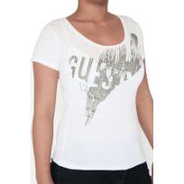 Guess - T-shirt manches courtes. Col rond échancré. Coupe ajustée, près du corps. Logo avec paillettes. 95% coton. 5% élasthanne