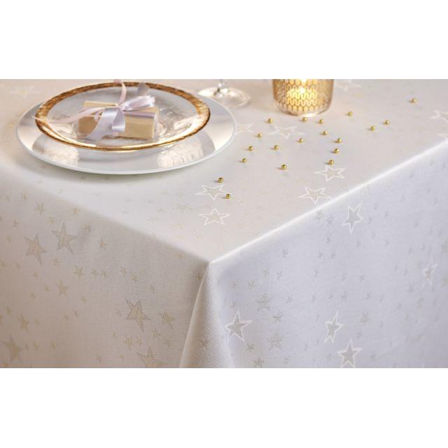 TEX HOME Nappe fantaisie en polycoton Une table de fête réussie ! Nappe ronde, en polycoton, constellée d'étoiles dorées. Dimensions : 150x150 cm. Matière : 75% polyester/25% coton.